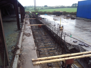 Construction Stage: Foundations showing Foundation rebar and holding down bolts
