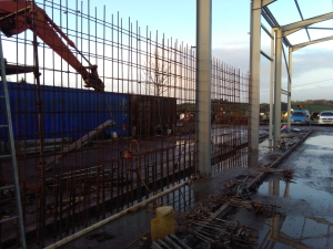 Construction Stage: Concrete Walls showing Rebar for mass concrete walls which are tied to steel columns