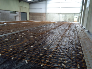 Construction Stage: Industrial Floor Slab before concrete pour showing dpm, steel mesh, movement joint